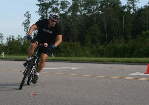 John Tenney on his mountain bike in a time trial